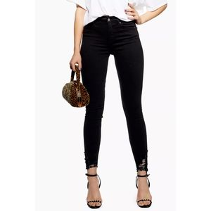Topshop's Black Ripped Hem Jamie Skinny Jeans